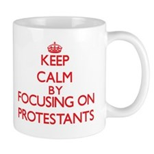 Keep Calm by focusing on Protestants Mugs