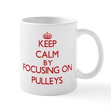 Keep Calm by focusing on Pulleys Mugs