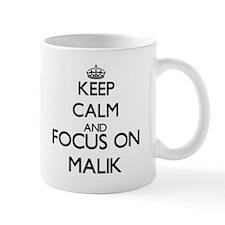 Keep Calm and Focus on Malik Mugs