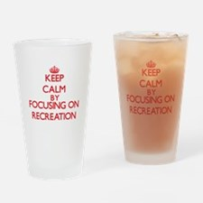 Keep Calm by focusing on Recreation Drinking Glass