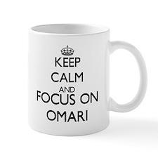 Keep Calm and Focus on Omari Mugs