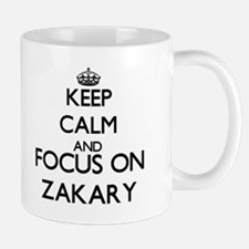 Keep Calm and Focus on Zakary Mugs