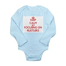 Keep Calm by focusing on Rustlers Body Suit