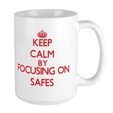 Keep Calm by focusing on Safes Mugs
