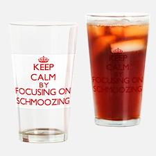 Keep Calm by focusing on Schmoozing Drinking Glass