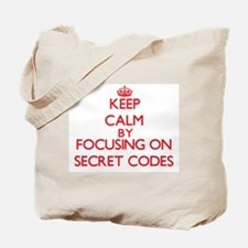Keep Calm by focusing on Secret Codes Tote Bag
