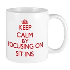 Keep Calm by focusing on Sit-Ins Mugs