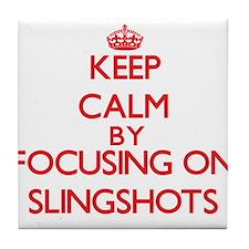 Keep Calm by focusing on Slingshots Tile Coaster