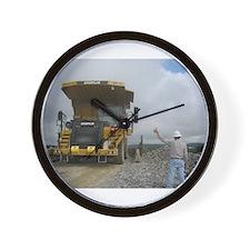 Truck getting hand signal to dump Wall Clock
