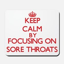 Keep Calm by focusing on Sore Throats Mousepad