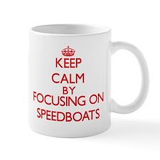 Keep Calm by focusing on Speedboats Mugs