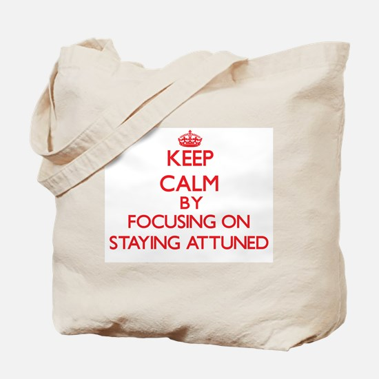 Keep Calm by focusing on Staying Attuned Tote Bag
