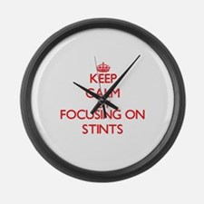 Keep Calm by focusing on Stints Large Wall Clock