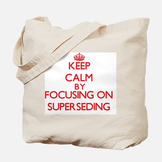 Keep Calm by focusing on Superseding Tote Bag