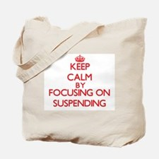 Keep Calm by focusing on Suspending Tote Bag