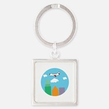 Plane Over City Keychains