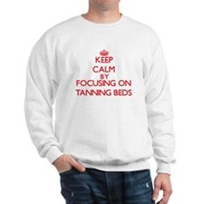 Keep Calm by focusing on Tanning Beds Sweatshirt