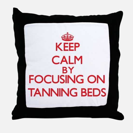 Keep Calm by focusing on Tanning Beds Throw Pillow