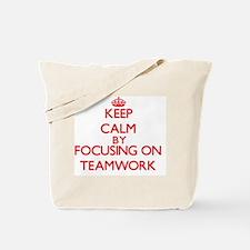 Keep Calm by focusing on Teamwork Tote Bag