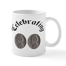 celebratingdoublenickle.jpg Mugs