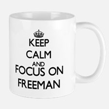 Keep calm and Focus on Freeman Mugs