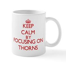 Keep Calm by focusing on Thorns Mugs