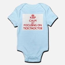 Keep Calm by focusing on Tick-Tack-Toe Body Suit