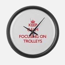 Keep Calm by focusing on Trolleys Large Wall Clock