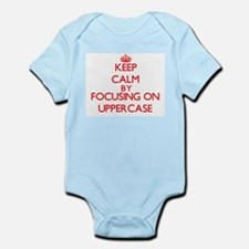 Keep Calm by focusing on Uppercase Body Suit