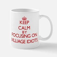 Keep Calm by focusing on Villiage Idiots Mugs