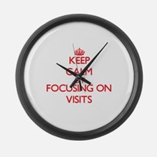 Keep Calm by focusing on Visits Large Wall Clock