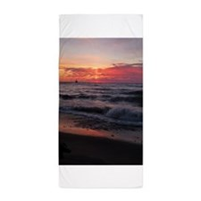 Sunset with waves Beach Towel