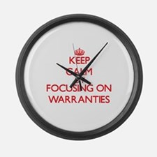 Keep Calm by focusing on Warranti Large Wall Clock