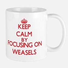 Keep Calm by focusing on Weasels Mugs