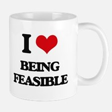 I Love Being Feasible Mugs
