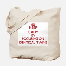 Keep Calm by focusing on Identical Twins Tote Bag