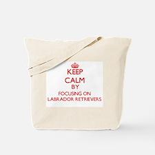 Keep Calm by focusing on Labrador Retriev Tote Bag