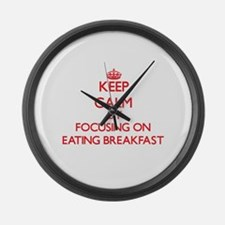 Keep Calm by focusing on Eating B Large Wall Clock