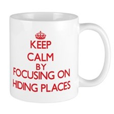 Keep Calm by focusing on Hiding Places Mugs