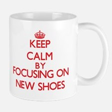 Keep Calm by focusing on New Shoes Mugs