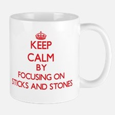 Keep Calm by focusing on Sticks And Stones Mugs