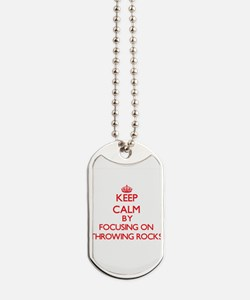 Keep Calm by focusing on Throwing Rocks Dog Tags
