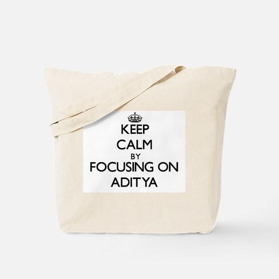 Keep Calm by focusing on on Aditya Tote Bag