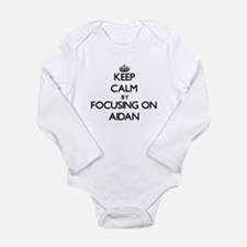 Keep Calm by focusing on on Aidan Body Suit