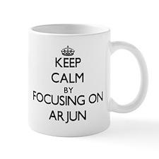 Keep Calm by focusing on on Arjun Mugs