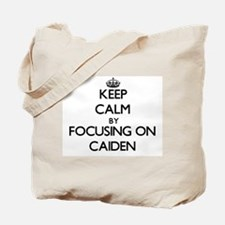 Keep Calm by focusing on on Caiden Tote Bag