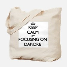 Keep Calm by focusing on on Dandre Tote Bag