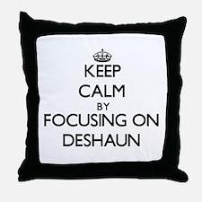 Keep Calm by focusing on on Deshaun Throw Pillow
