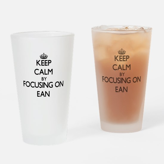 Keep Calm by focusing on on Ean Drinking Glass