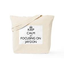Keep Calm by focusing on on Jaydon Tote Bag